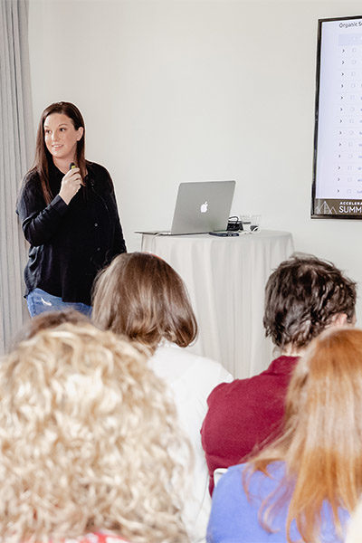 Shelly Fagin at Adthrive Summit 2019 presenting to a room full of bloggers on using SEMrush tools